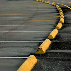 Leading Stripes by Noel Hankamer - Abstract Patterns ( tarmac, parking lot, asphalt, curb, paint, yellow, gray, stripes )