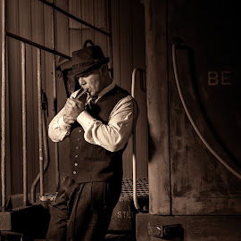 waiting by David Hardy - People Portraits of Men ( cigar, david hardy, oklahoma, 2015, retro, train, night, dave's lifestyle photography, man )