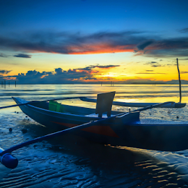 The boat and the sunrise by Daimasala Abdullah - Transportation Boats ( freedom, travel, house, heat, people, sabah, asian, borneo, sky, village, nature, tourism, malaysia, vacation, horizontal, gypsy, labuan, coral, unique, nomadic, wooden., waterscape, tropical, ocean, beauty, landscape, coast, sun, island, clear, life, happy, sunny, asia, clouds, water, sand, peaceful, romantic, sea, seascape, scenic, crystal, boat, paradise, sunset, background, summer, scenery, sunrise )