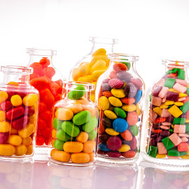 by Myra Brizendine Wilson - Food & Drink Candy & Dessert ( candy in bottle, candy, food, glassware, food photography, colored candy in glasses )