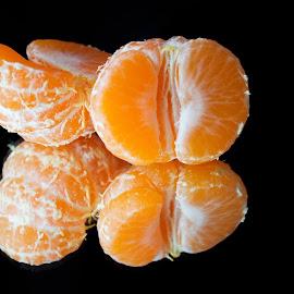 Reflection by Suzana Trifkovic - Food & Drink Fruits & Vegetables ( orange, fruit, mandarin, tangerine, ripe, half, healthy, halves, black )