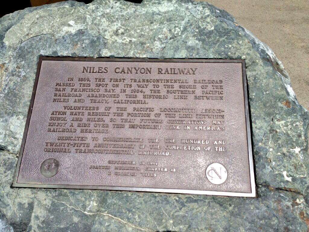 IN 1869, THE FIRST TRANSCONTINENTAL RAILROAD PASSED THIS SPOT ON ITS WAY TO THE SHORE OF THE SAN FRANCISCO BAY. IN 1984, THE SOUTHERN PACIFIC RAILROAD ABANDONED THIS HISTORIC LINE BETWEEN NILES AND ...
