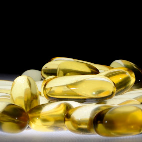 Fish oil by Mariusz Murawski - Products & Objects Healthcare Objects ( fish oil, pill, softgels, pills, gold, golden, softgel )