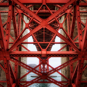 Golden Gate Underbelly by John Souza - Buildings & Architecture Bridges & Suspended Structures ( water, pwclandmarks, california, stone, suspension, sea, ocean, san fran, architecture, golden gate, steel, sky, red, cloud, bridge, san francisco )
