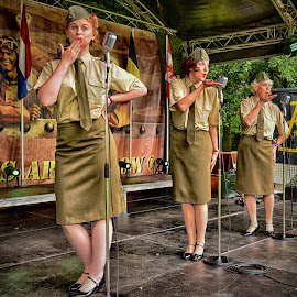 Sergeant Wilson's Ladies by Marco Bertamé - People Musicians & Entertainers ( army, uniform, woman, three, lady )