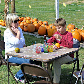 Painting Pumpkins by Rich Hooper - People Street & Candids ( pumpkins, fall colors, painting, family, colors )