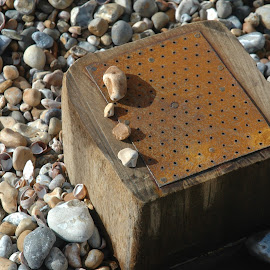 Post and pebbles by Mark Collins - Nature Up Close Rock & Stone ( pebble, groyne, post, metal, beach, rust )