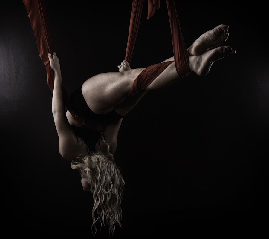 Red Ribbon Wrapped by Monte Arnold - People Fine Art ( suspend, wrap, silk, form, strength, bend, blond, feet, suspension, aerial, contortion, red, female, fly, woman, ribbon, swing, flexibility, dance, hair, women, lady, , color, colors, landscape, portrait, object, filter forge )