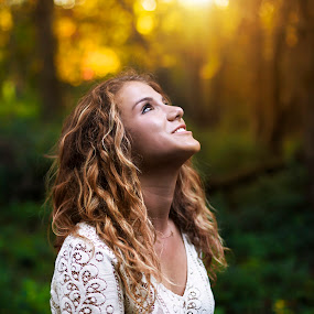 Seeking the golden light by Kyle Re - People Portraits of Women ( calm, peaceful, twilight, forest, glow, woods, bokeh, girl, serene, woman, sunset, lovely, smile, light, golden hour,  )