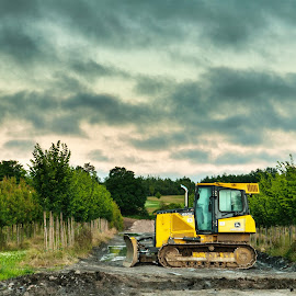 Lone Dozer by Herb Drummond - Transportation Other ( clouds, hdr, bulldozer, trees, cloudscape, hdr photography )