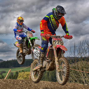 Close Duel by Marco Bertamé - Sports & Fitness Motorsports ( clouds, 225, chasing, speed, green, number, race, close, jump, noise, 151, sky, red, motocross, blue, grey, duel )