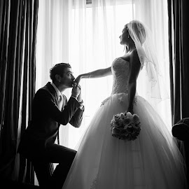 by the window by Jovan Barajevac - Wedding Bride & Groom ( srbija, novi sad, black and white, by the window, romantic, kissing hand, bride, wedding photo session, groom )