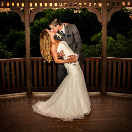 Sweep Her Off Her Feet by Matthew Chambers - Wedding Bride & Groom ( texas photographer, wine, wedding photography, kissing, wood, white, matthew chambers photography, creekside, austin wedding photographer, austin photographer, kiss, dip, wedding, sunset, wedding photographer, bride and groom, austin wedding, bride, groom )