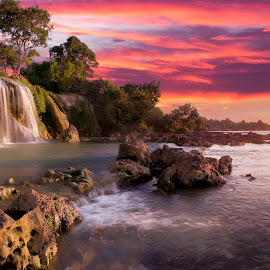 Sunset in Toroan Waterfalls by Paulus Widjanarko - Landscapes Waterscapes ( afternoon, waterfall, sea, ocean, seascape, morning, sunset, low tide, sunrise, rocks, ocean view, golden, golden hour )