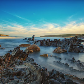 View of Petrel Cove rocks and waves by Nicole Rix - Landscapes Waterscapes ( sky, waterscape, blue, waves, rock formation, rocks )