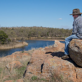 Silence on Top by Eva Ryan - People Street & Candids ( water, oklahoma, male, lake, landscape, rocks, man, wichita mountain wildlife refuge,  )