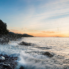 by Lean Mendieta - Landscapes Sunsets & Sunrises ( wave splash, splash, rocky beach, rocky, wave, sea, sunrise, seascape, beach, water splash )
