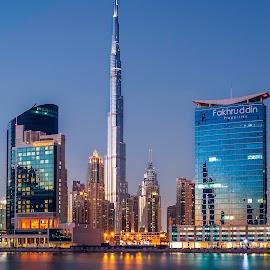 The Tallest of them All by Sergiu Chirilov - Buildings & Architecture Architectural Detail ( lights, dubai, sunset, buildings, reflections, architecture, nikon, burj khalifa, longexposure, dusk )