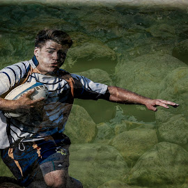Underwater Rugby by Keith Johnston - Sports & Fitness Rugby ( water, ball, player, action, sport, game, wet, rocks, rugby, athlete )