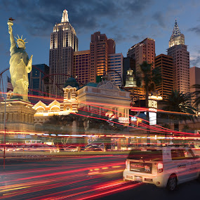 NYNY Edge of Night by Eric Yiskis - Buildings & Architecture Office Buildings & Hotels ( las vegas, new york new york, sunset, time lapse, nevada, light trails, casino, hotel, strip, city at night, street at night, park at night, nightlife, night life, nighttime in the city )