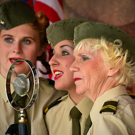 Entertaining Army by Marco Bertamé - People Musicians & Entertainers ( army, ladies, microphone, singing, green, cap, woman, sgt wilson, three, trio, entertainment )
