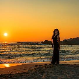 Sunset at Rena Majori by Maurizio Mameli - Landscapes Sunsets & Sunrises ( woman, sunset, sea, summer, seascape, beach, landscape, beach wedding, sun )