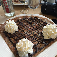 Buckwheat pancake with chocolate sauce and cream