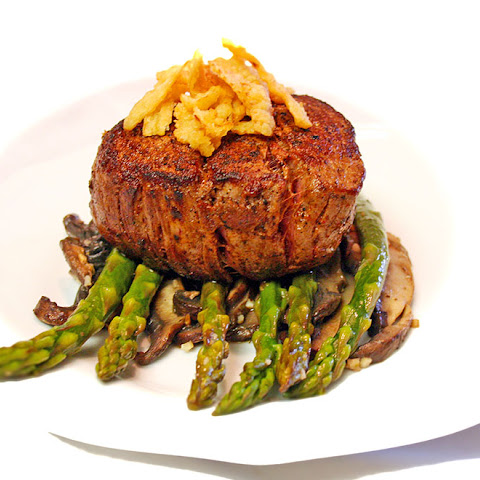 Filet Mignon On Asparagus Spears And Portobello Mushrooms
