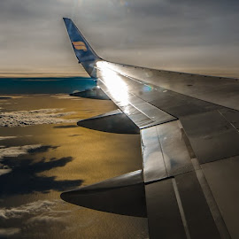 the horizon by Hafsteinn Kröyer Eiðsson - Transportation Airplanes ( clouds, reflection, skyline, wing, atlantic ocean, airplane, cloudscape, horizon, sunlight, iceland, icelandair, above, winglet, earth, high, ocean view, daylight )