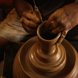 Moulding one ... by Praphul G Krishna - Artistic Objects Cups, Plates & Utensils