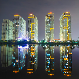 City mirror in the night by Bảo Long - City,  Street & Park  Skylines ( exposure, mirror, skyline, night, vietnam, travel, saigon, long, light, around, city )