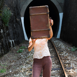 Woman and vintage suitcase on railway road by Deyan Georgiev - Transportation Trains ( baggage, fashion, old, person, railroad, way, retro, line, wait, travel, road, transportation, people, caucasian, adventure, girl, transport, woman, rail, train, trip, alone, shoes, suitcase, vintage, bag, waiting, beautiful, journey, traveler, departure, tourism, passenger, tourist, vacation, railway, female, outdoor, summer, brown, tunnel )