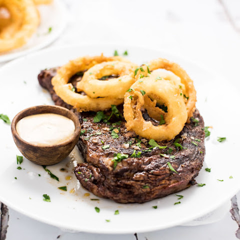 Chili-Rubbed Ribeye Steak with Beer-Battered Onions Rings