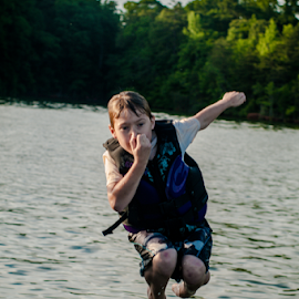 Boy Jumping off Boat by Myra Brizendine Wilson - People Fashion ( young boy, boy jumping off boat, boat, boy,  )