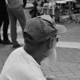 man watching the band by Thomas Shaw - People Portraits of Men ( black and white, ball cap, cap, white, oak city 7, raleigh, photography, north carolina, hat, oc7, hand, beard, bricks, tee shirt, man )
