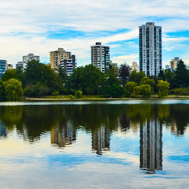 Vancouver's West End during sunrise by Cory Bohnenkamp - City,  Street & Park  City Parks ( water, park, buildings, reflections, lost lagoon, sunrise, vancouver, city )