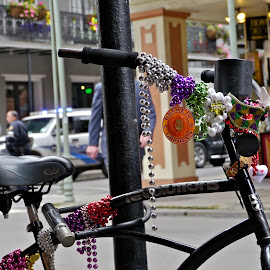 A Bike in  Nawlins by Daniel Bottoms - City,  Street & Park  Historic Districts ( new orleans, street, french quarter, beads, bicycle,  )