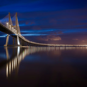 the bridge at night by Emanuel Ribeiro - Landscapes Waterscapes ( clouds, night, lisbon, bridge, river )