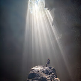Ray of Life by Indrawaty Arifin - Landscapes Caves & Formations ( woman, cliff, dark, ray of light, cave )