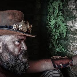 Steampunk Corner by George Petropoulos - People Portraits of Men ( blueeyes, brick, moss, beard, leather, steampunk, hat )