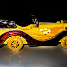 Wooden Car by Aamir Soomro - Artistic Objects Antiques ( car, head-lights, reflection, old, wood, karachi, yellow, sindh, bokeh, lights, pakistan, toy, brown, antique, black )