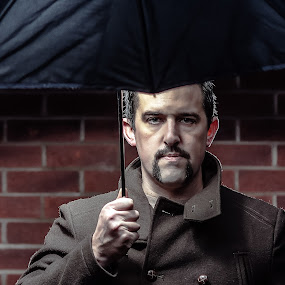 Cold Movember Rain by Michael Ripley - People Portraits of Men ( movember, flash, brick wall, umbrella, moustache, handlebar )