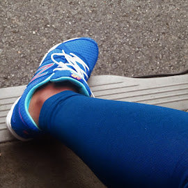 Blue Calf by Davina Michelle - People Body Parts ( car, shoes, leg, blue, white, blue shoes, brown, cement, gray )