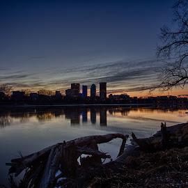 A Moment by Jim Harvey - City,  Street & Park  Skylines ( water, red river, tree, sunset, winnipeg, log, river, manitoba )