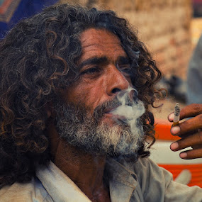 Self-righteousness has killed more people than smoking... by Yuni  Khan - People Portraits of Men ( smoking, smokers, yuni khan, mallangs of pakistan, yuni's photography, Travel, People, Lifestyle, Culture )