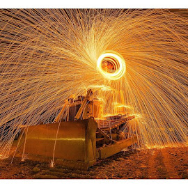 Sparks Fly over Earth Mover.I took this the same night as my previous photo.This earth mover was alone in a nearby paddock.I couldn't resist.# bulldozer by Dean Brandt - Abstract Light Painting ( longexposure, nightphotography, spinningsteelwool, nikonaustralia, wow_australia, instagram, fantastic_earth, loves_longexpo, amazingnight, sparks, wow, awesome, ig_australia, ig_nightphotography, longexposureoftheday, longexposure_shots, supreme_nightshots, amazing_longexpo )