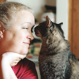 Woman's Best Friend by Rob Heber - Animals - Cats Playing ( interior, natural light, cat, person, furry, indoors, cute, domestic animal, snunggle, shallow depth of field, love, pose, staring, gazing, woman, precious, friendship, mamal, smile, feline, smiling, animal, profile, communication, sunlight, posing, portrait, pet portrait, real people, blonde, female, pet, head in hand, gaze, selective focus, tender moment, whiskers, lady, buddies, adorable, pals, house cat )