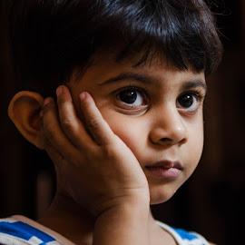 Serious thinking by Manindra Mukherjee - Babies & Children Child Portraits ( child, children candids, child portrait, children, childhood )