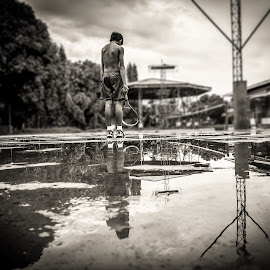 Some people walk in the rain, others just get wet by Poci Jacildo - Sports & Fitness Tennis ( water, reflection, wet, tennis court, tennis, rain )