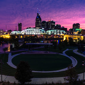 Nashville  by Erik Lykins - City,  Street & Park  Skylines ( tn, skyline, location, skyscrapers, architecture, cityscape, travel, attraction, city, nashville 01064, cumberland river, nashville, buildings, music city, 2015, riverwalk, twilight, a6000, tourism, dusk, destination, landmark, tourist, cities, cumberland park, outdoors, scene, view, waterfront, travel photography, famous, america, usa, photography, southern, skyscraper, no people, american, evening, downtown, sightseeing, water, office, building, night scene, riverfront, tennessee, scenic, united states of america, urban, north america, color, sunset, outdoor, night, scenery, river )